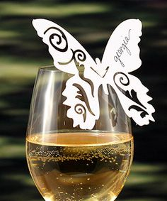 Delicate butterfly card perched on the rim of wine glasses or hung from the ceiling