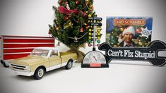 "Looking for creative gifts for the automotive enthusiast in your life? Shown in the picture are some of our top suggestions: Chevy C10 Model Truck, National Lampoons Christmas Vacation Card Scramble board game, Mini Tool Box, Drag Race Christmas Tree Alarm Clock, and ""Can't Fix Stupid"" tin sign.  Christmas Vacation, Christmas Tree, Christmas Ornaments, Motorcycle Gifts, Lampoons Christmas, Cant Fix Stupid, Man Cave Gifts, Summit Racing, National Lampoons"