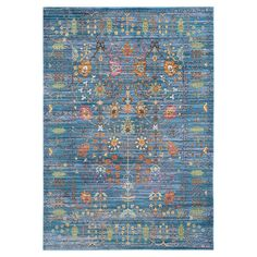 Stylishly anchor your living room seating group or define space in the den with this artfully crafted rug, showcasing a Persian-inspired motif and blue hue. ...