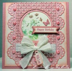 I love the way she has cut the embossed section to lay atop the punched scalloped edge. This is very symmetrical and appealing!