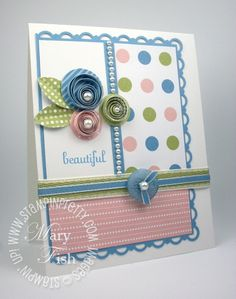 quilling.. I might actually be able to do this simple Quilling project. I mostly love the card layout.
