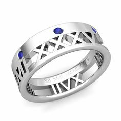 Love More Roman Numeral Sapphire Wedding Band in Gold, Design and handcrafted by My Love Wedding Ring. This unique custom made roman numeral wedding ring with your special date showcases seven vibrant blue sapphires set in a gold band. Tungsten Wedding Bands, Wedding Ring Bands, Diamond Gemstone, Gemstone Rings, Tungsten Bracelet, Sapphire Wedding Rings, Titanium Rings, Couple Rings, Love Ring