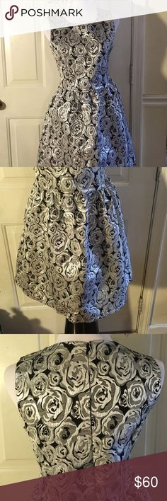 Eros Apparel dress size S Black dress with silver roses flare out dress. Great for the holiday size small eros apparel Dresses