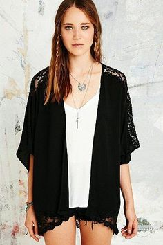 Kimonos are everywhere right now.   Check out how I made one out of a T-shirt.   No sewing required.