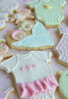 These are part of a set I made for a friend to take to a baby shower. They are orange sugar cookies with fondant and royal icing. Galletas Cookies, Baby Cookies, Iced Cookies, Cute Cookies, Royal Icing Cookies, Cupcake Cookies, Sugar Cookies, Baby Shower Cakes, Baby Shower Treats