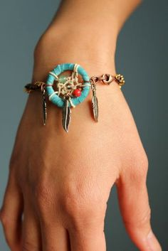 Turquoise leather and silver feather dreamcatcher bracelet.