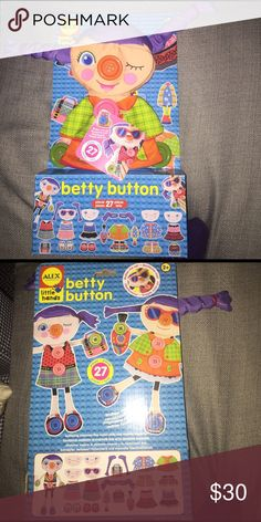 ALEX Toys Betty Button by ALEX Toys Mix and match to create an endless number of outfits for Betty! Dress Betty in different faces, hairdos, dresses, coats and more. Use the chunky buttons to fasten her clothes. A wonderful activity for developing fine motor skills. Includes doll with 9 chunky buttons, faces, hairdos, dresses, coats, shoes and fashion accessories. Learn while having fun, part of the Little Hands Skill Builder series by ALEX. An award winning children's product from Alex…