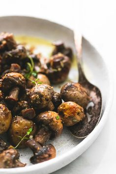 Quick and easy 15-minute sautéed garlic butter mushrooms are bursting with flavor and make the perfect side dish or appetizer for any dinner recipe. | lecremedelacrumb.com