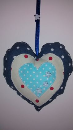 One of a set of three hanging hearts