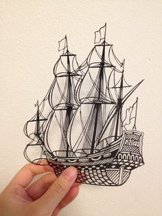 Layered handmade paper cut sailing ship in shadow by SinyeeCraft