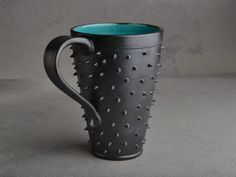 Tall Spiky Mug Black and Caribbean Blue by symmetricalpottery, $23.00