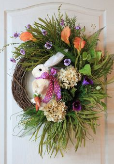 Beautiful cream Hydrangeas, purple and orange Lilies, plus purple wild flowers, ferns, lime green ivy, and very unique grass, makes this a very gorgeous wreath for your front door or in your home for Easter! So beautiful!!
