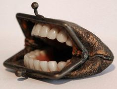"""Purse with Teeth"" by surrealist taxidermy artist, Nancy Fouts."