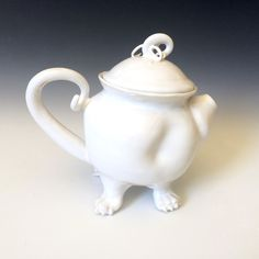 A Creature teapot, the gods have struck again. This is a friendly little pug like teapot that will gladly fetch you tea, be careful, when his tail wags it knocks everything over. He is the silent type, he doesn't yap and make you crazy.  He's just so ugly, he's cute. Just the way I like my teapots.                                                                                                                                                                                                ...