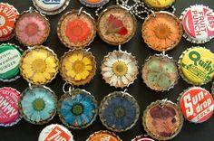 recycled bottle cap jewelry with real flowers, embedded in resin inside vintage cork lines soda pop caps