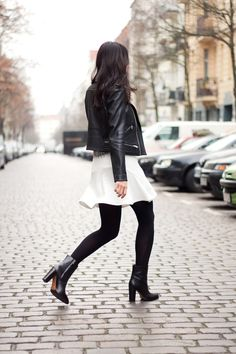 Street Style December 2014: Kayla Seah is wearing a leather jacket from Maje, white skirt from The Fifth and the boots are from & Other Stories