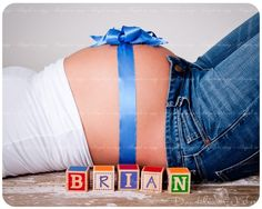 Cute maternity picture.  Since we don't know the gender and therefore don't have final names, maybe we could put the due date instead.