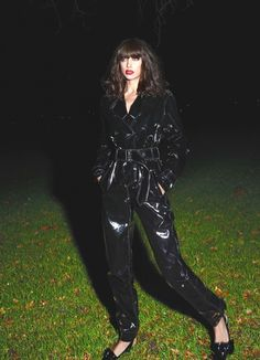Irina Shayk models a glossy black jumpsuit for the fashion spread