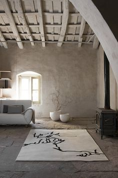 Rug based on a design by Eduardo Chillida artist. The rug is from Nani Marquina in Barcelona.Love-Spain