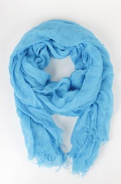 Add a pop of color with the Wanderlust Scarf in Delray Ocean