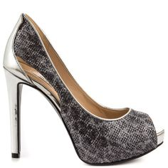 Hip hip hooray to the sultry Harrahly by Guess. This gorgeous silhouette features a sparkling leopard print texture with cut out details at the side. A peep toe, 4 1/2 inch heel and 3/4 inch platform complete this bold and striking pump.