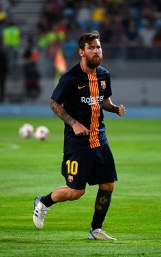 Barcelona's Argentinian forward Lionel Messi warms up ahead of the Spanish Super Cup final between Sevilla FC and FC Barcelona at Ibn Batouta Stadium in the Moroccan city of Tangiers on August Messi Fans, Messi And Neymar, God Of Football, Cristiano Ronaldo Juventus, Leonel Messi, Soccer Players, Fc Barcelona, August 12, Photo Credit