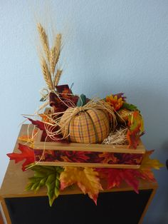 Ribbon, dried flowers and gourds, fabric leaves and pumpkin