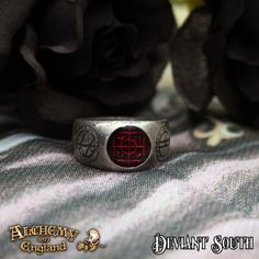 Alchemy Gothic AG-R71 Agla ring UK T  A pewter band ring engraved with magical talismans, with the central one beneath a translucent purple enamel.