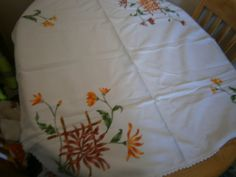 vintage heavy orange flower embroidered table cloth by HABERDASHERYHAVEN on Etsy