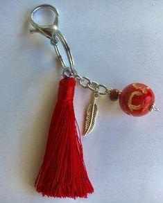 Bijou de sac porte clés pompon rouge breloque perle de bois