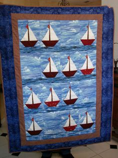 3D - You can put your hand entirely behind the sails and the flag is a prairie point. Don't use horizontal looking sky fabric, use mottled all-over and let it just suggest sky. If you do use sky like I did, you will have to cut the pieces to each side of the boat at a 60 degree angle.