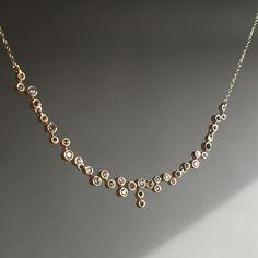 Scattered diamond section necklace by Nicole Landaw. #14k #diamonds #nicolelandawjewelry #finejewelry #jewellery #lovegold #futureheirlooms #augustla