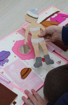 This is a unique gift for girl. A wooden doll can be dress in the beautiful clothes of felt. In the book 4 interactive pages.