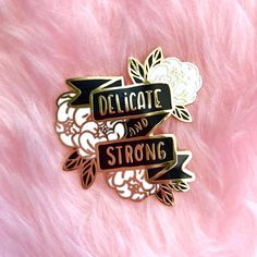 This is a listing for the Delicateand Strong hard enamel pin in white and black.  The pins are approximately 4 cm and have gold metal lining. Comes in 3 colour variants, so check out my two other listings!  Self love and appreciation is important. Its alright to cry, and sometimes that