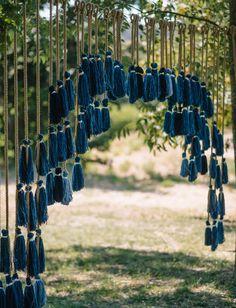 indigo tassel backdrop for a bohemian rustic wedding