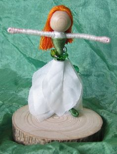 Sale Christmas Flower Fairy Waldorf by TracysGardenFairies-dolls are handmade wire-wrapped dolls. I wrap them with cotton floss which has a lovely sheen and does not pill with age. They are usually about 3 inches tall and fully pose-able.