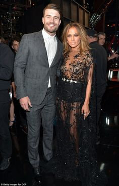 Backstage: J.Lo posed with country singer Sam Hunt after she presented him with the Best N...