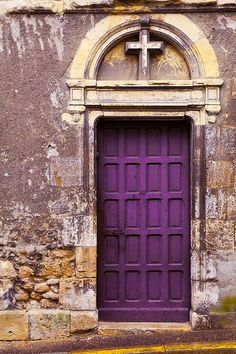 purple door with a cross.