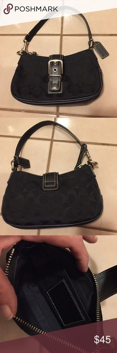 """Coach Small Black Signature Bag Excellent condition. Some minor wear on bottom. Canvas upper with leather bottom, strap and flip closure. Silver tone hardware. Zipper closure with a flip buckle magnetic closure in front. Leather Coach hangtag. Leather pull on zipper. About a 6"""" strap drop. Approximately 8"""" wide x 4.5"""" high x 2"""" deep. Creed No. F042-6363. Not from a smoke free house. Coach Bags Mini Bags"""
