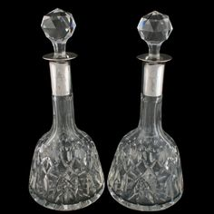 Pair of Sterling Silver Top Decanters