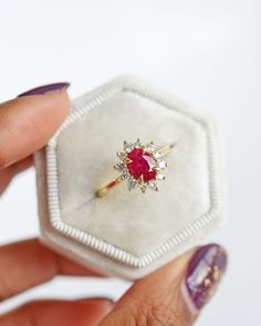 """[ringsize=""""5-7.25""""] Bold and eye-catching, this gorgeous one of a kind ruby diamond engagement ring has vintage vibes mixed with a modern halo made with diamonds from Canada. - Ready to ship as a size 5.75 with limited resizing available- Center stone: 1.25ct ruby- Halo: 0.36 tcw diamonds Canadian-origin brilliant cut white diamonds- Metal: 14K yellow gold We offer ring sizers for those unsure of their size. td {border: 1px solid #ccc;}br {mso-data-placement:same-cell;} Ruby Engagement Ring Vintage, Ruby Wedding Rings, Dream Engagement Rings, Engagement Ring Sizes, Halo Diamond Engagement Ring, Ruby Ring Vintage, Tiffany Engagement, Red Wedding, Senior Rings"""