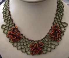 """Ruffled Flowers at Sova-Enterprises.com This is a simple net weaving pattern with a few additions. It hangs beautifully and is a great piece to wear.  Project Type: Bead Stitch: Net weave Beads Used: Size 8 green, brown and orange seed beads, 8mm brown bicone crystal Approx Finished Size: 18"""" Pages to Print: 7  Designer/Supplier: Cecilia Rooke"""