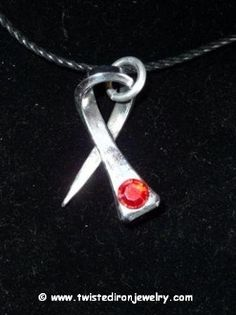 Cancer Ribbon Horseshoe Nail Necklace coated with clearcoat to prevent rust.  http://www.pinterest.com/twistedironshop/twisted-iron-jewelry/