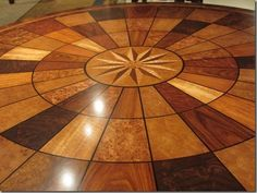 From Theodore Alexander, the incredible details on this table with dozens of types of woods.