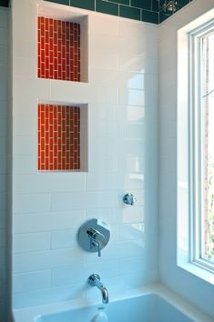 contemporary bathroom, fresh and clean lines, orange accent tile reveal for shelves, white tile in shower with green tiles above, clean and contemporary fixtures