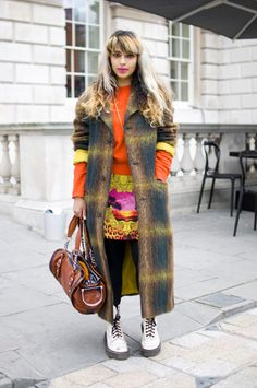 What: London Fashion Week    She: Ameena Kara Callender, stylist & costume designer    Wears: Skirt: Versace for H    Sweater and coat: Vintage    Bag: Balenciaga    Shoes: Dr. Martens