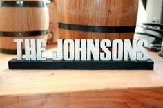 Love this display sign for wedding decor, home decor, or a wedding gift. Personalized Wooden Family Name Sign Display Wooden Family Name Sign, Family Name Signs, Sign Display, Display Shelves, Unique Wedding Gifts, Make And Sell, Wedding Signs, Wedding Decorations, Names