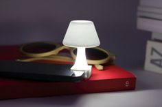 Your iPhone flashlight clamps onto this little lamp to become a bedside nightlight. How awesome is that!