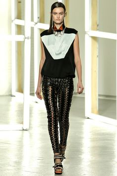 Rodarte #8--These tough leather skinnies are the perfect foil for the bejeweled tuxedo top. And I love the black, red and mint color combo.