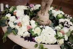laguna-gloria-fountain-floral-candles.jpg 3,861×2,574 pixels
